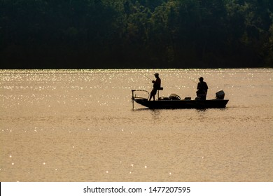 Fishing Boat Silhouette on the Lake