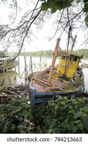 fishing boat stranded in a river once used to catch fish by local fishermen