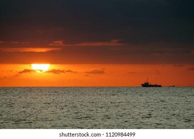 (Fishing boat) Sunrise at Santa Susana beach, Costa Brava, Catalonia, Spain