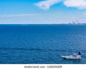 Fishing boat and Tokyo Bay Aqua line. The Tokyo Bay Aqua Line is a bridge and tunnel route across Tokyo Bay from Kawasaki in Kanagawa Prefecture to Kisarazu in Chiba Prefecture.