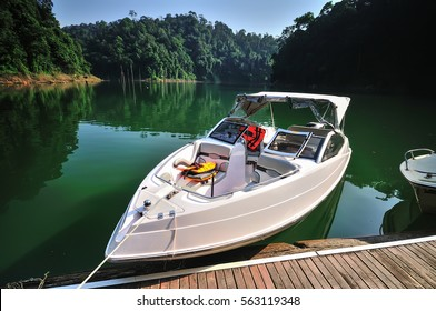 Fishing boat (tourist boat ) at tropical rain forest at Kenyir Lake in Terengganu, Malaysia, It is the largest man-made lake in South East Asia.