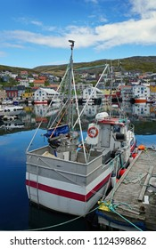 Fishing boat and town. Honningsvag, Norway . 19th June 2018. For editorial use only