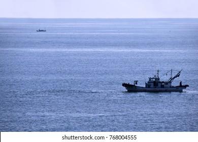 Fishing boat in winter sea.