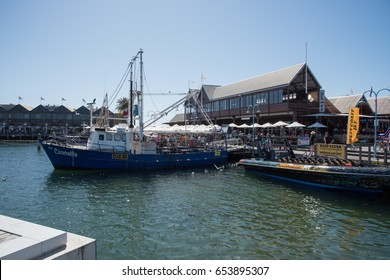 Fishing boat,crowds and fish restaurants in Fremantle, Western Australia/Harbour Scene/FREMANTLE,WA,AUSTRALIA-NOVEMBER 13,2016: Fishing boat, crowds and fish restaurants in Fremantle,Western Australia
