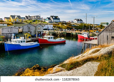Fishing boats anchored and waiting in a secluded bay in Peggy's Cove, Nova Scotia, Canada