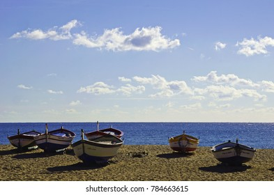 Fishing boats at the beach of Calella Barcelona during summertime