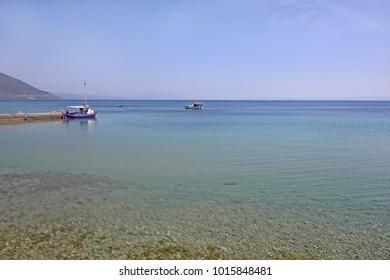 Fishing boats in blue sea water