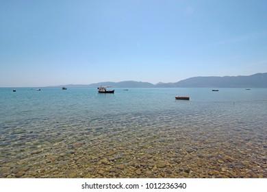 Fishing boats in blue water