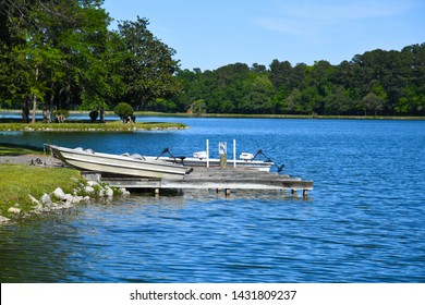 Fishing Boats at the Boat Dock on a Recreational Fishing Lake