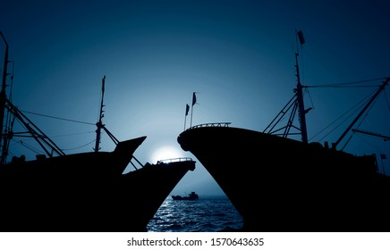 The fishing boats docked at the sea