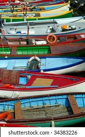 Fishing boats docked in Torri Del Benaco on Lake Garda, Italy
