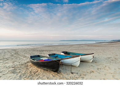 Fishing boats at Durley Chine on Bournemouth beach in Dorset