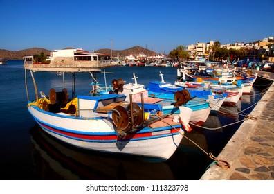 Fishing boats in Elounda (Crete, Greece). Elounda is a small fishing town on the northern coast of the island of Crete, Greece.