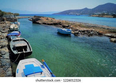 Fishing boats in Elounda. Small traditional fishing boats line a canal in the picturesque town of Elounda on the island of Crete.