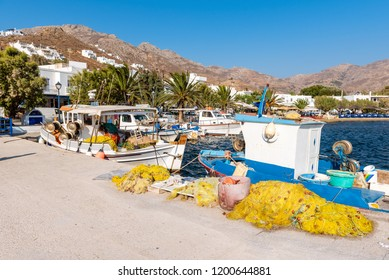 Fishing boats with fishnets in the port of Livadi. Serifos island, Greece