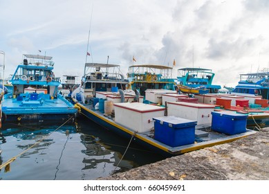 Fishing boats in the harbor in city Male, capital of Maldives