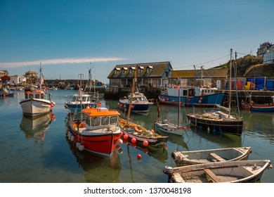 Fishing boats in the harbor of Mevagissey in Cornwall England