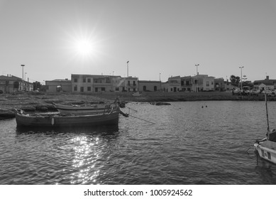 Fishing boats in the harbor of the fishing village - monochrome