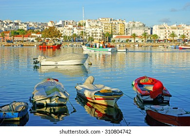 Fishing boats in the historic Harbor of Lagos on a beautiful summers day, Lagos, The Algarve, Portugal