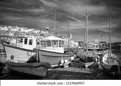 Fishing boats in the inner harbour at Mevagissey on a beautiful tranquil day, South Cornwall, United Kingdom