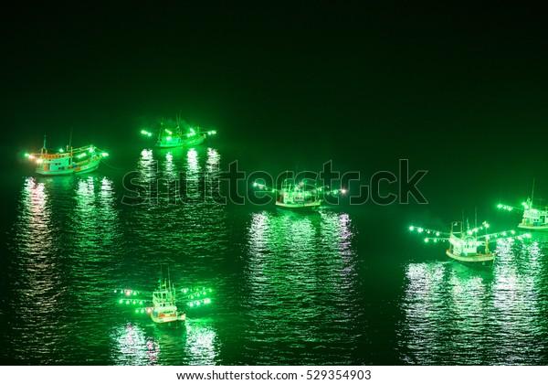 Fishing boats and lights at night