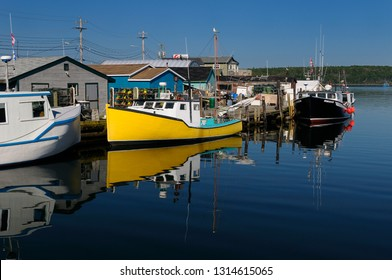 Fishing boats and lobster traps at Fishermans Cove Eastern Passage Halifax, Nova Scotia, Canada - July 20, 2009