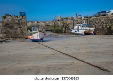 Fishing boats at low tide in the harbor of Newquay