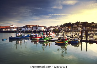 Fishing boats moored in the harbor of Saint Jean de Luz, in the Pays Basque, France.