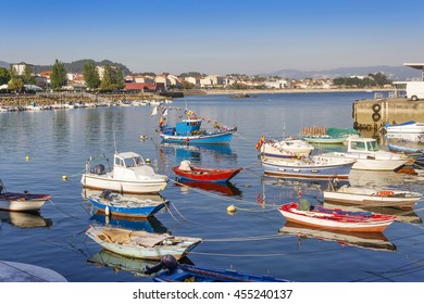 Fishing boats moored on the dock in Cangas do Morrazo city