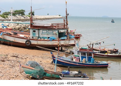 Fishing boats moored on the shore.