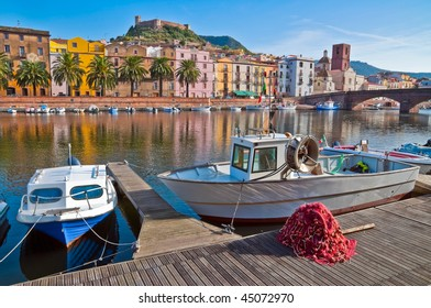 Fishing boats and nets on the river in Bosa in Sardinia, Italy