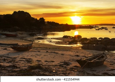 Fishing boats on Abilleira beach, Arousa Island, at sunset
