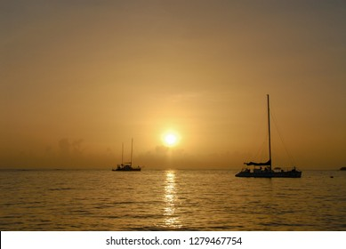 Fishing boats on the Adaman Sea during golden sunset