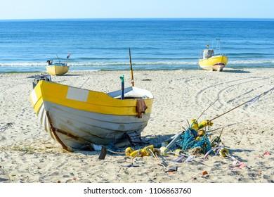 Fishing boats on Baltic Beach in Piaski near Krynica Morska, Poland