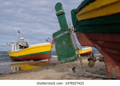 Fishing boats on the beach of Baltic Sea in Sopot/Poland - close-up of the boat propeller and rudder blade.
