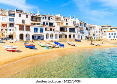 Fishing boats on beach in Calella de Palafrugell, scenic village with white houses and sandy beach with clear blue water, Costa Brava, Catalonia, Spain