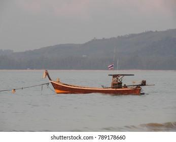 Fishing boats on the beach of Khao Lak