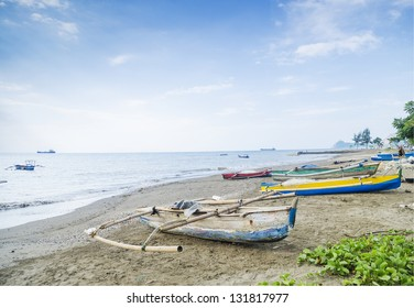 fishing boats on dili beach in east timor