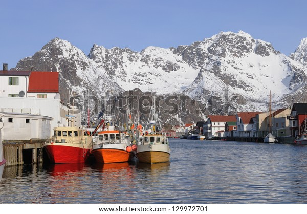 Fishing boats on the harbor, Henningsvaer, Lofoten Norway, on a sunny winter day.
