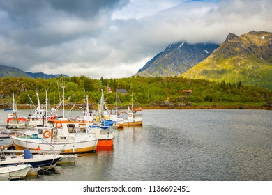 Fishing boats on moutain background, Lofoten island, Norway