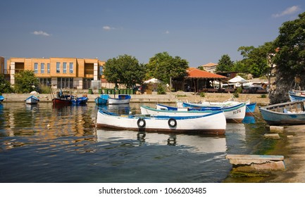 Fishing boats on the pier in Bulgaria. Summer, blue sky it the afternoon.