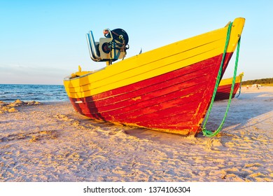 fishing boats on the sandy beach during sunset - Baltic Sea Poland