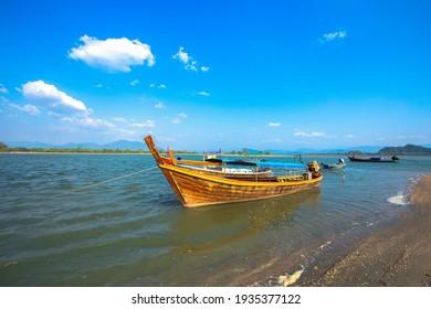 fishing boats on a sandy seashore, atlantic ocea