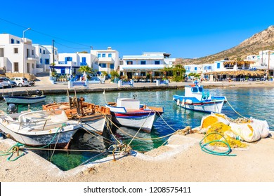 Fishing boats on turquoise sea water in Finiki port, Karpathos island, Greece