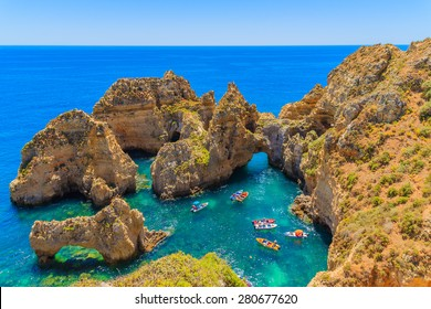 Fishing boats on turquoise sea water at Ponta da Piedade, Algarve region, Portugal