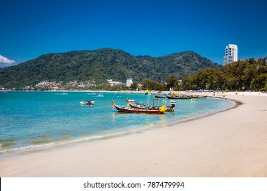 Fishing boats at Patong beachin Phuket, Thailand. Phuket is a popular destination famous for its beaches.