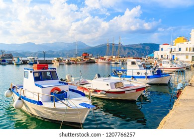 Fishing boats in Pigadia port on Karpathos island at sunset time, Greece