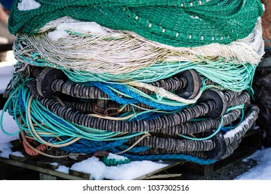 Fishing boats in the Polish fishing port on the Baltic. Fishing accessories, nets and ropes on a boat for fishing. Winter season.