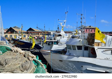 fishing boats in the port of Genoa, Italy
