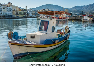 Fishing boats at the port of Pigadia at Karpathos island on a sunny day,  Greece